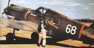 Charles Older - R. T. Smith in front of Older's P-40B in Kunming, China