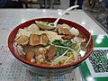 Chinese noodle soup with octopus ball and lamb meat with pork belly and fu jok.jpg