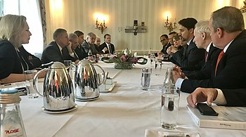 Chris Coons and Justin Trudeau MSC2020 meeting.jpg