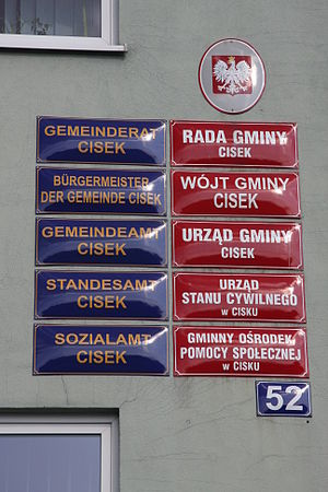 German minority in Poland - Example of bilingual labeling in German and Polish on the town hall of the Polish village Cisek.