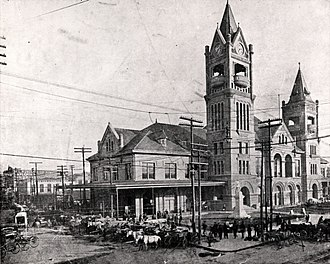 Houston City Hall - The City Hall and Market House, located on Travis Street at Prairie Avenue, was shared by the Houston city government and the city market.(1904)