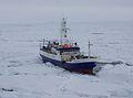 Coast Guard Cutter Polar Star navigates to beset fishing vessel 150213-G-DE731-003.jpg