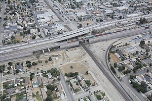 Colton Crossing - An aerial view of the grade separation. Interstate 10 is visible, running parallel to the flyover immediately to the north.
