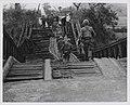Company M, 3.7 Marines cross a destroyed bridge near Duc Pho.jpg