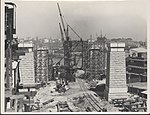 Construction of the northern piers of the Sydney Harbour Bridge, 1927 (8282696673).jpg