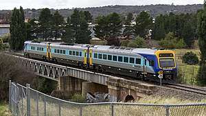 CountryLink Xplorer crossing the Queanbeyan River Railway Bridge (cropped).jpg