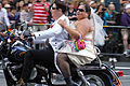 Couple on a bike (9180325890).jpg
