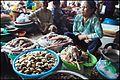 Crab vendor on Hội An Central market (14488368890).jpg
