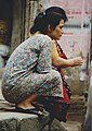 Crouching and sleeping woman Nepal.jpg