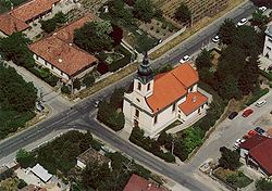 Aerial photograph of Csömör showing the Roman-Catholic church