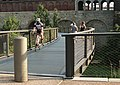 Cyclist riding on the walkway in the North Gateway on the Arch grounds. (5d8340ac-9313-4b81-b4a3-9e243a3880d8).jpg