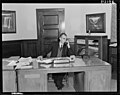 D.T.M. at desk. PHOTOGRAPHER J.F. Le Cren, F.G. Tingay and R.A.O. Morgan DATE 1953.jpg