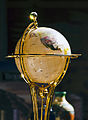 Decorative globe with prismatic burst at top.jpg