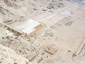 Deir el-Bahari - The three temples at Deir el Bahari from the top of the cliff behind them, part of Hatshepsut's temple on left, Tuthmosis III's temple in center, and Mentuhotep II's temple on right.
