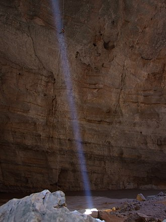Light beam - A natural lightbeam in the Majlis al-Jinn (literally 'Meeting place of the jinn') cave in Oman