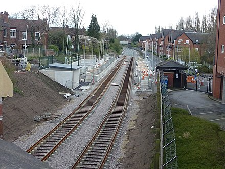 Phase 3 included the re-opening of the disused railway line through Didsbury Didsbury Village Metrolink Stop Under Construction (geograph 3185533).jpg