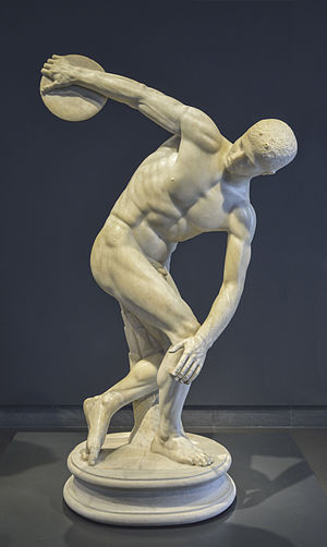 "Ancient Olympic Games - The ""Discobolus"" is a copy of a Greek statue c. 5th century BC. It represents an ancient Olympic discus thrower"