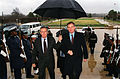 Donald Rumsfeld holds an umbrella for Geoffrey Hoon.jpg