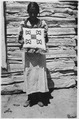 Dorothy Grey Hound displays a pillow she made from muslin scraps - NARA - 285647.tif