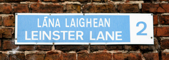Postal addresses in the Republic of Ireland - Post-1961 Dublin street sign displaying the street name in Irish and English, with postal district number