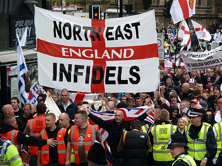 The National Front cooperated with the North West Infidels and South East Alliance, groups that splintered from the English Defence League (rally depicted). EDL2.jpg