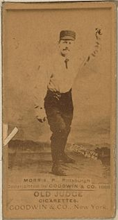 "A baseball card featuring a player wearing a white shirt and dark pants throwing a baseball. The bottom of the card reads ""MORRIS, P., Pittsburgh Copyrighted by GOODWIN & CO. 1888"""