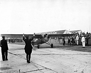 Eddie August Schneider - Eddie August Schneider landing at Roosevelt Field on August 25, 1930, after completing round trip transcontinental flight
