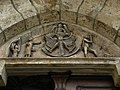 Eisenerz - Wehrkirche hl Oswald - Tympanon mit Wappen und Szene Vertreibung aus dem Paradies.jpg