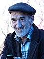 Elderly Man in Market - Quba - Azerbaijan (17855356329).jpg