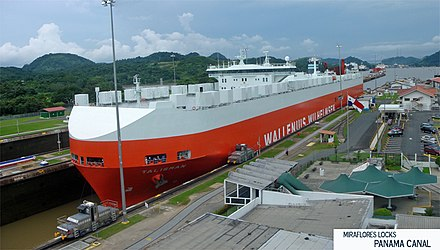 A Panamax ship in transit through the Miraflores locks, Panama Canal Exclusa Miraflores Canal de Panama Panorama.jpg