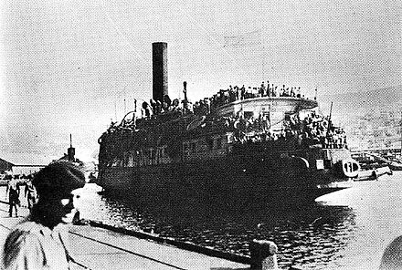 The Exodus, formerly President Warfield, arriving at Haifa (British Admiralty photo) Exodus 1947 ship.jpg