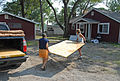 FEMA - 30616 - Women carrying particle board to a damaged Missouri home.jpg