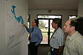 FEMA - 31005 - Disaster recovery officals look at a map in Texas.jpg