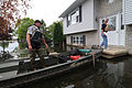 FEMA - 37357 - FEMA and local police inspect a home via boat in Wisconsin.jpg
