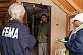 FEMA - 39900 - FEMA Community Relations workers speak with a resident in Washington.jpg
