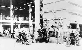 Hawaii Democratic Revolution of 1954 - Asian plantation workers filling bags of sugar during the 1910s.