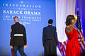 First lady Michelle Obama, right, waves to ball attendees while U.S. Marine Corps Gunnery Sgt. Timothy Easterling, left, and Air Force Staff Sgt. Bria Nelson depart after dancing with President Barack H. Obama 130121-A-TT930-043.jpg