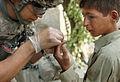 Flickr - The U.S. Army - 10th Mountain Medic treats Afghan boy.jpg
