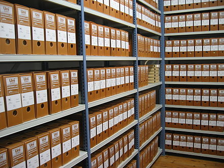 Shelved record boxes of an archive. Fondos archivo.jpg