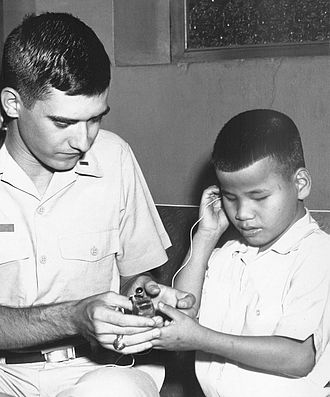 Forrest Mims - Forrest Mims demonstrates his infrared obstacle-sensing device at the Saigon School for Blind Boys in 1967