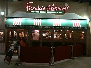 Frankie & Benny's - Night time appearance of entrance to a Frankie and Benny's restaurant, located at Xscape, Glasgow