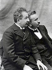 Auguste and Louis Lumire brothers seated looking left