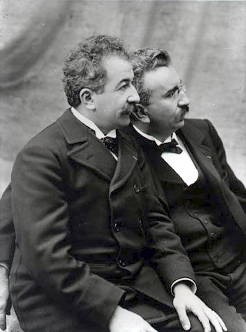 Auguste and Louis Lumière brothers seated looking left