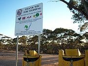 Fruit disposal bins and warning signs along the Calder Highway, approaching Mildura.