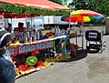Fruit stand selling mavi at a car show in Puerto Rico.jpg