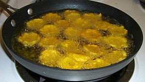 Tostones as they are fried a second time.