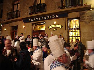 Txoko - A gathering of chefs in front of the Gaztelubide txoko during the Tamborrada.