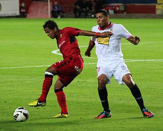 Giovani dos Santos - Dos Santos against Sevilla midfielder Hedwiges Maduro