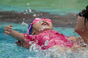 English: Learning to swim on her back