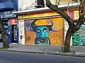 Graffiti hombre multicolor calle San Luis.jpg